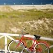 Red beach cruiser bicycle. — Stock Photo