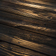 Sunset reflected on wood. — Stock Photo