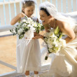 Bride and flowergirl. — Stock Photo