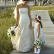Stock Photo: Bride and flower girl walking.