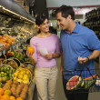 Stock Photo: Couple grocery shopping.