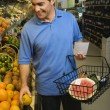 Man grocery shopping. - Stock Photo