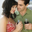 Couple Drinking Red Wine - Stock Photo