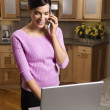 Woman on Cell Phone with Laptop - Stock Photo