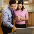 Couple looking at laptop. — Stock Photo #9499272
