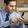 Man dialing cell phone. — Stock Photo