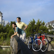 Couple on Bridge with Bicycles — Stockfoto