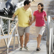 Couple at marina. - Stock Photo