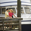 Couple at dock. - Stock Photo
