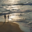Aerial of couple on beach. — Stock Photo #9499695