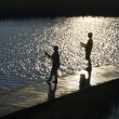 Stock Photo: Boys fishing on dock.