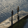 Boys fishing on dock. — Stock Photo #9499700