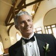 Smiling groom in church. — Stock fotografie