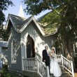 Bride and groom leaving church. — Stock Photo