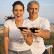 Royalty-Free Stock Photo: Couple Drinking Wine on Beach