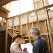 Couple looking at new house. - Stock Photo