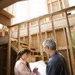 Couple looking at new house. — Stock Photo