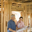 Couple Building Home — Stock Photo #9499844