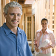Couple Building Home — Stock Photo #9499852