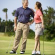 Stock Photo: Couple talking on golf course
