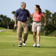 Couple walking on golf course — Foto Stock #9499880