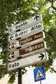 Directional and Pedestrian Crossing Signs in Lisbon — Stock Photo