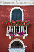 Arched Window with Balcony and Flowers — Stock Photo