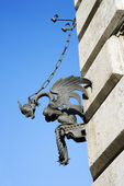 Gargoyle chained to wall. — Stock Photo