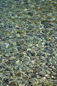 Rocks in clear water. — Stock Photo