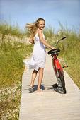Girl Walking Bike on Boardwalk. — Stock Photo