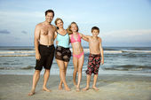 Happy smiling family on beach. — Stock Photo