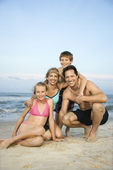 Smiling happy family on beach. — Stock Photo