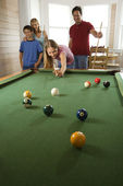 Family Playing Pool in Rec Room — Stock Photo
