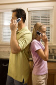 Man and Young Girl on Phones — Stock Photo