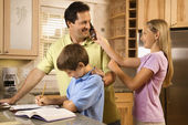 Family in Kitchen — Stock Photo