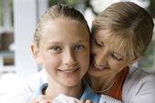 Mom hugging daughter. — Stock Photo
