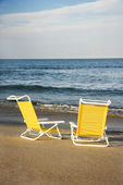 Lounge chairs on beach. — Stock Photo