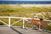 Red beach cruiser bicycle. — Stok fotoğraf