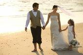 Bride, groom and flower girl. — Stock Photo