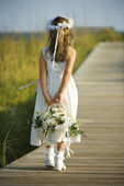 Flower Girl on Boardwalk — Stock Photo