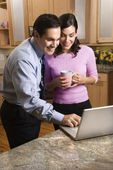 Couple with laptop. — Stock Photo