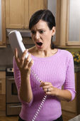 Woman Holding Phone in Disbelief — Stock Photo