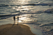 Aerial of couple on beach. — Stock Photo
