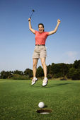 Happy woman golfing. — Stock Photo