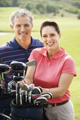 Couple on golf course. — Stock Photo