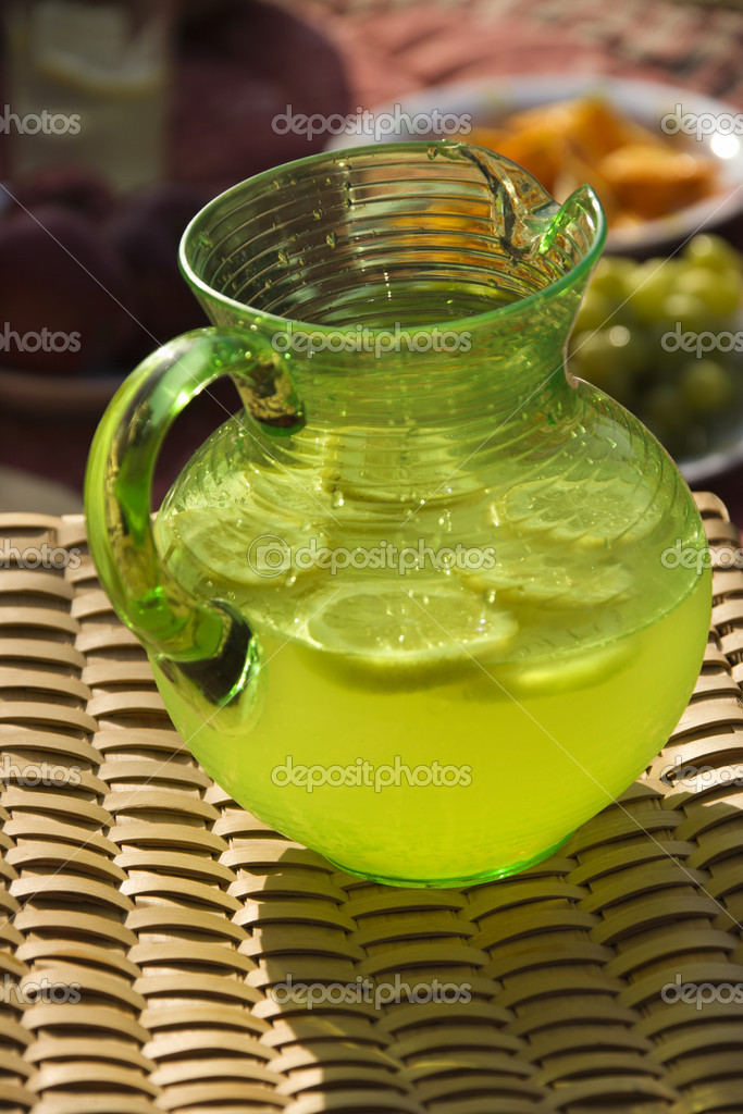 Pitcher of lemonade with sliced lemons. — Stock Photo #9498417