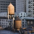 Rooftop Water Towers on NYC Buildings - Stock Photo