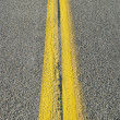 Stock Photo: Double yellow lines in road.