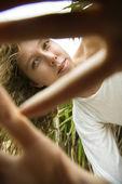 Woman peeking out. — Stock Photo