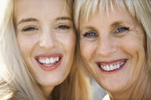 Mom and daughter smiling. — Stock Photo